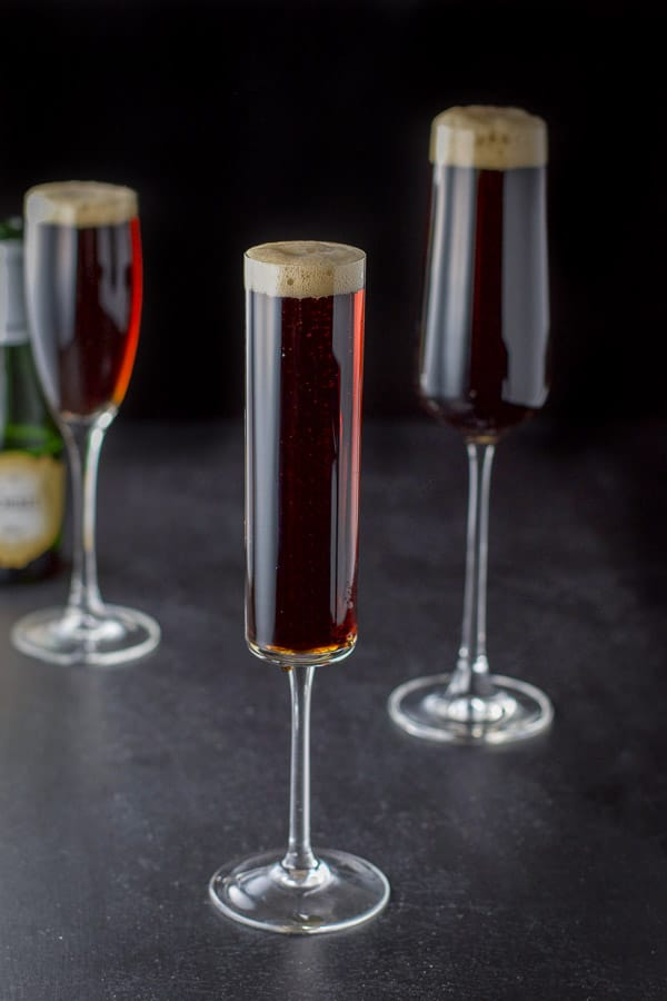 Champagne poured into the Guinness red velvet cocktail