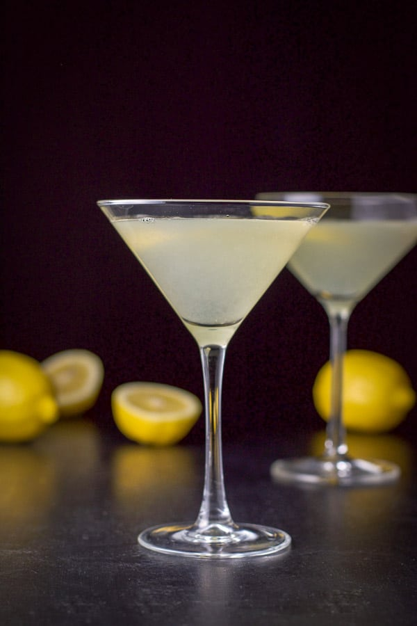 Vertical view of the lemon drop martini with the smaller glass in front