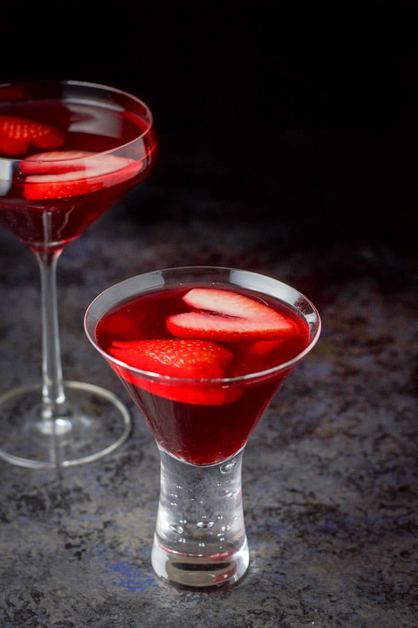 Short glass filled with the love martini in front