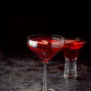 The love martini in a tall glass and a shorter glass