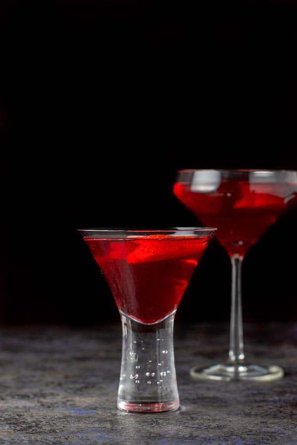 A vertical view of the love martini, short glass in front