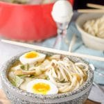 Shot of the udon noodle soup with the egg in the bowl