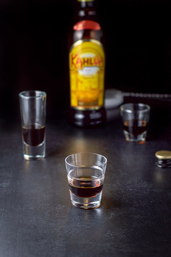 Kahlua poured out for the B52 shot recipe