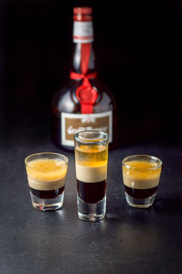Grand Marnier layered into the glasses filled with the B52 shot recipe