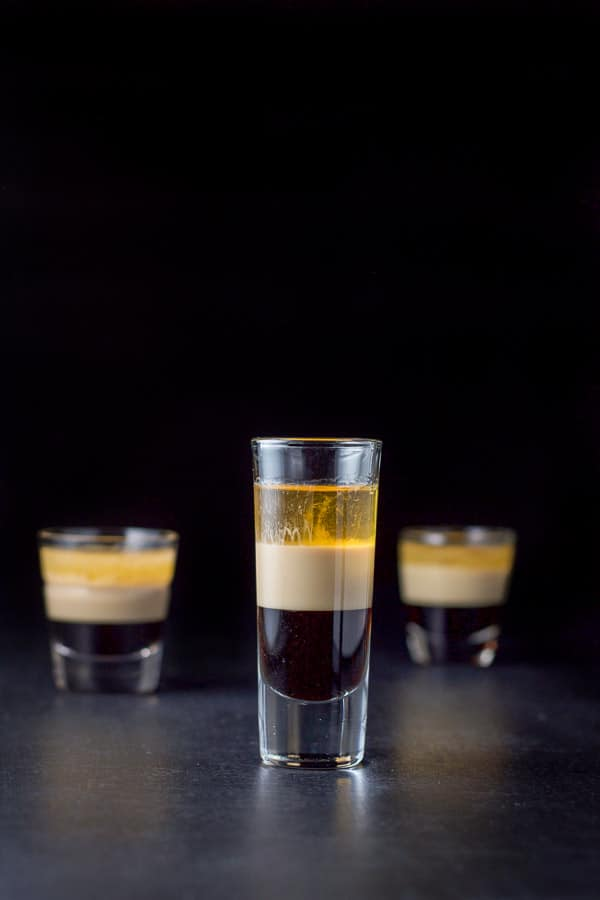 Vertical view of the tall glass filled with the B52 shot recipe