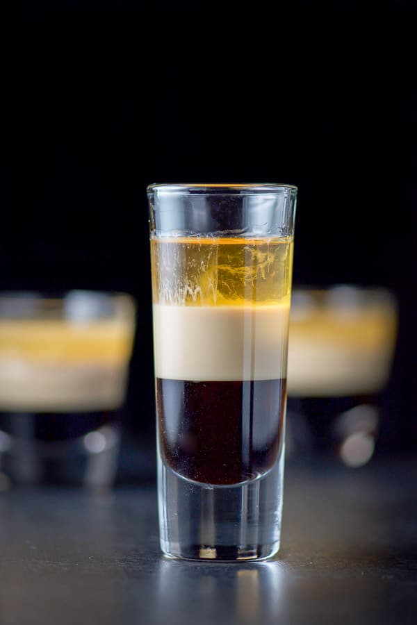 Close up of the tall glass filled with the B52 shot recipe