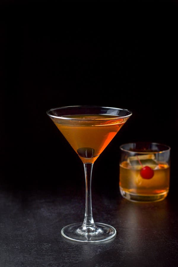Martini glass filled with bourbon Manhattan