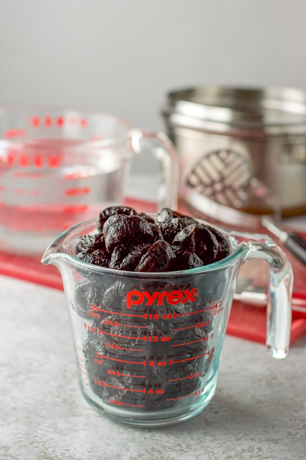 Prunes in a measuring cup ready to be made into prune spread