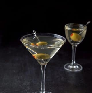 Two martini glasses filled with the vodka dirty martini
