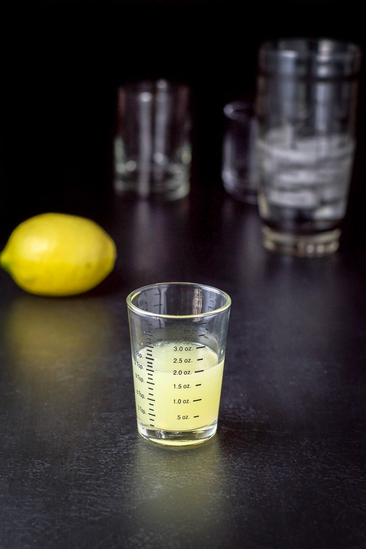 Lemon juice measured for the bramble cocktail recipe