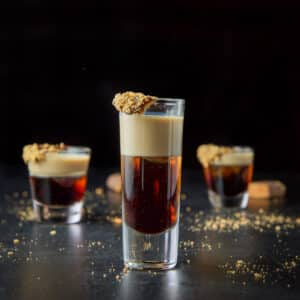 Tall glass filled with the Butterfingers shot - square