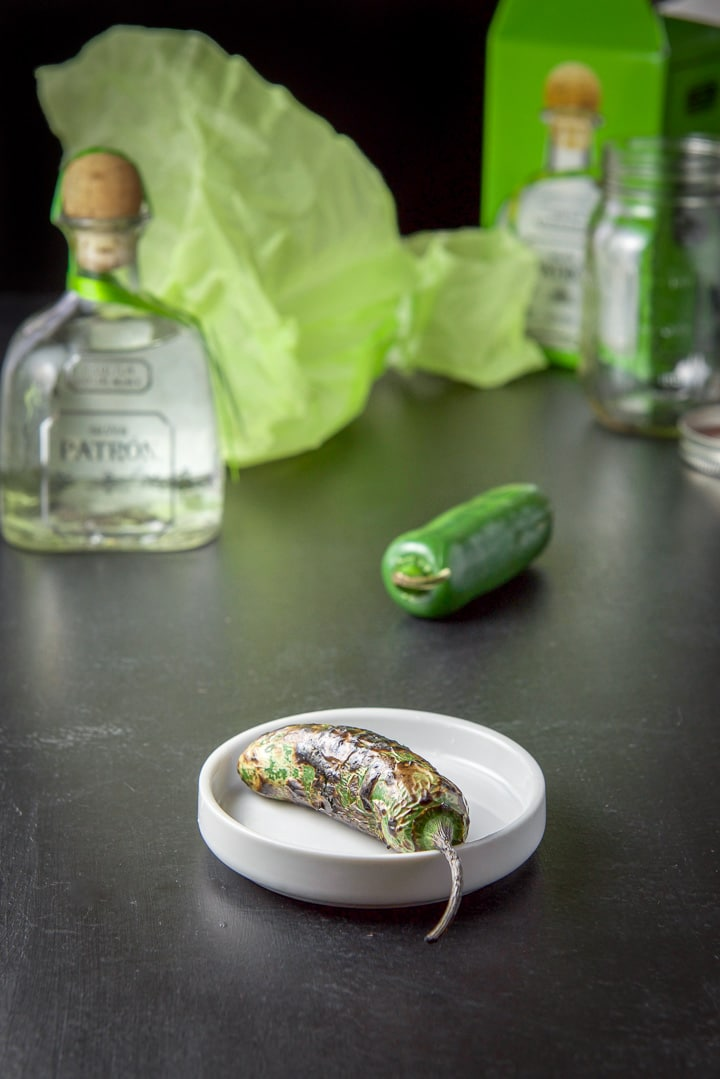 A roasted jalapeno in front for the jalapeño infused tequila