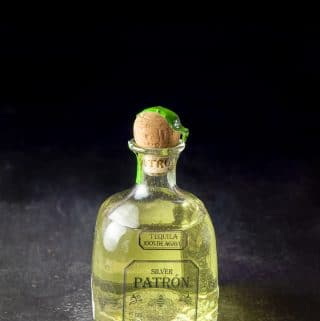Jalapeno infused tequila poured back into the bottle