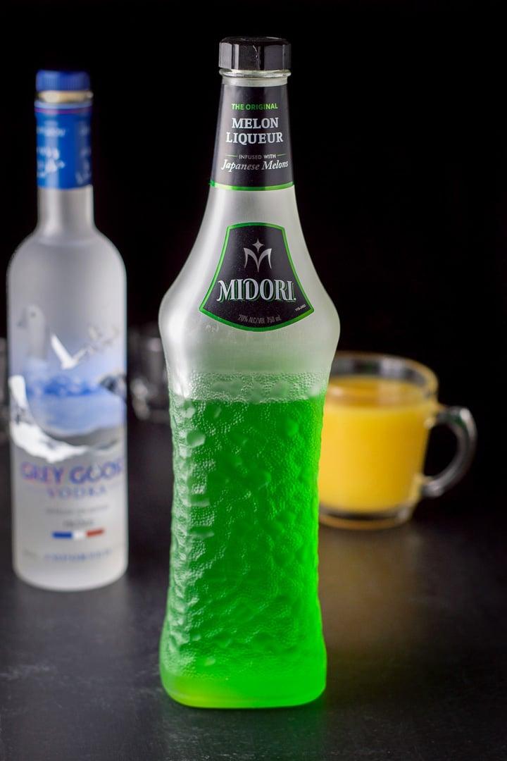 Midori, Grey Goose and orange juice for the melon ball shot