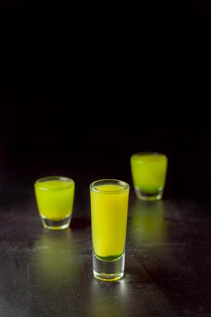 Orange juice layered into the melon ball shot