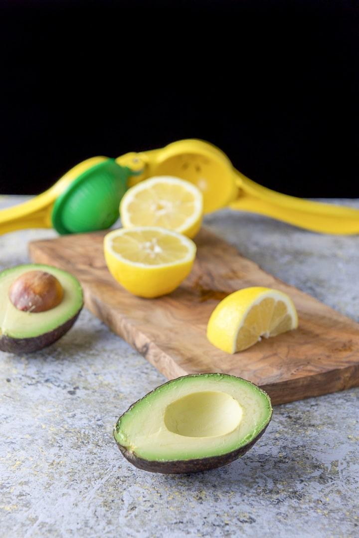 Avocado and lemons cut for the parsley avocado spread