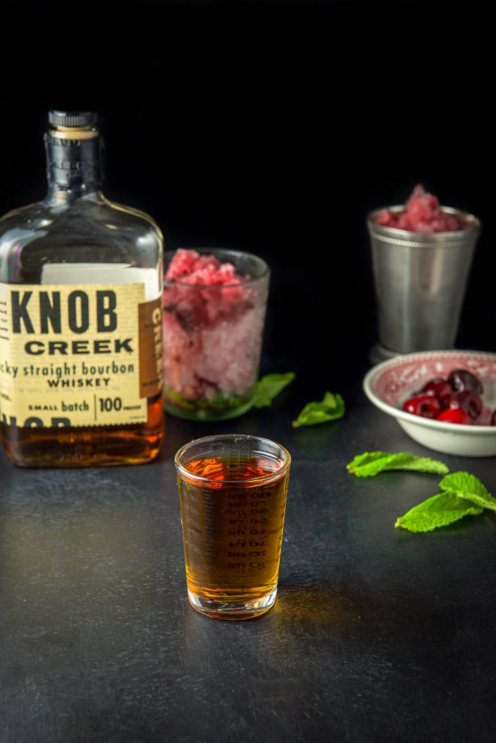 Bourbon measured for the cherry mint julep