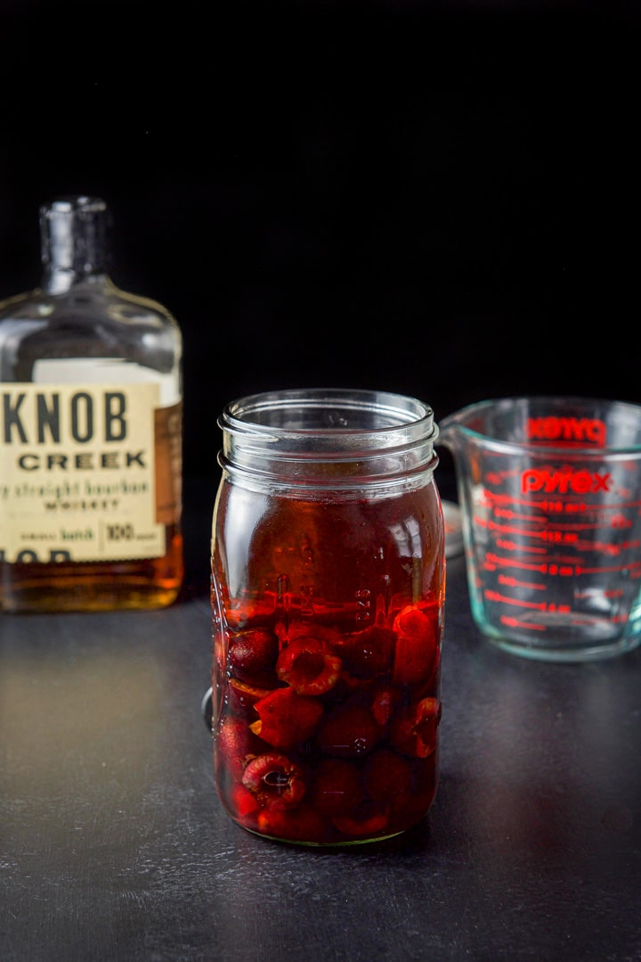 Bourbon poured into the jar to make the cherry infused bourbon