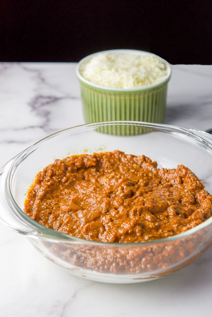 Chili spread over the cream cheese for the chili cheese dip