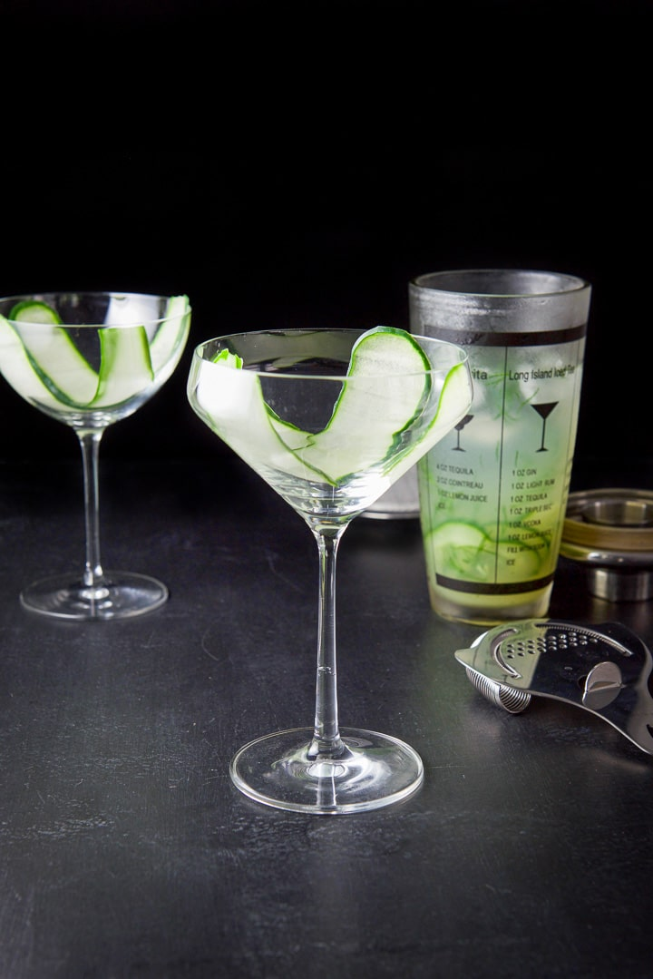 Thin cucumber slices draped in the glasses for the cucumber dill martini
