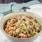 Closer look for the farro salad in a beige bowl