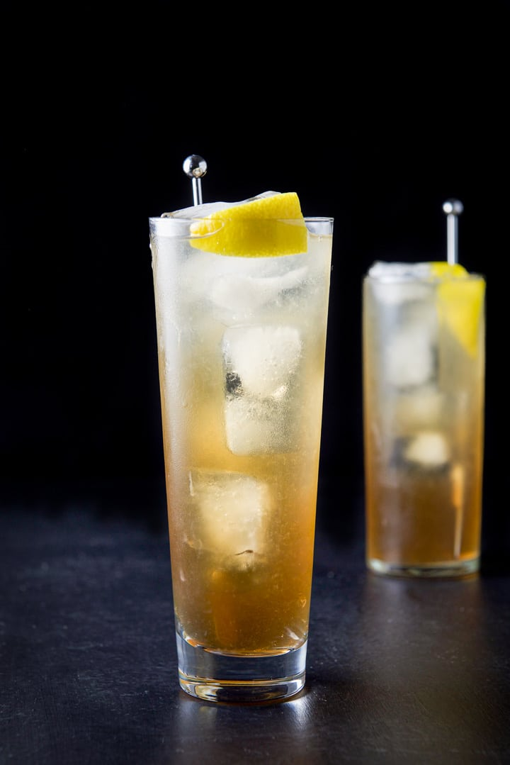 Vertical view of the wider glass filled with the Long Island iced tea cocktail