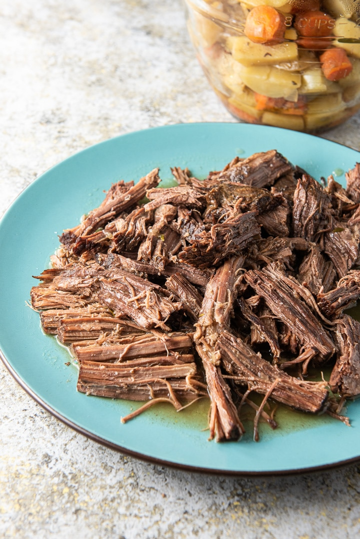 Instant pot bottom round roast shredded on a platter