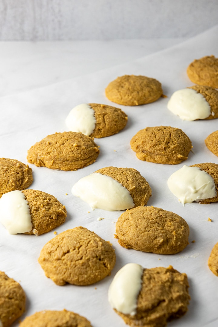 Pumpkin cream cheese cookies dipped in white chocolate