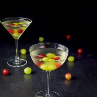 Higher view of the bowl shaped glass filled with the white grape cosmo