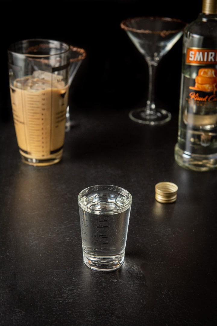 Caramel vodka measured for the Godiva chocolate martini