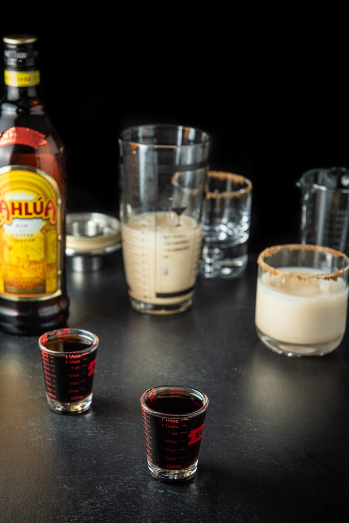 Kahlua poured for the pumpkin spice white Russian