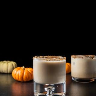 Vertical view of the pumpkin spice white Russian with the bubble glass