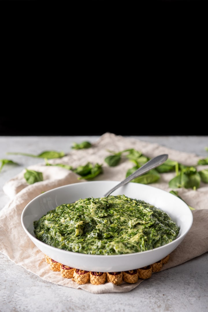 A big bowl of German style creamed spinach