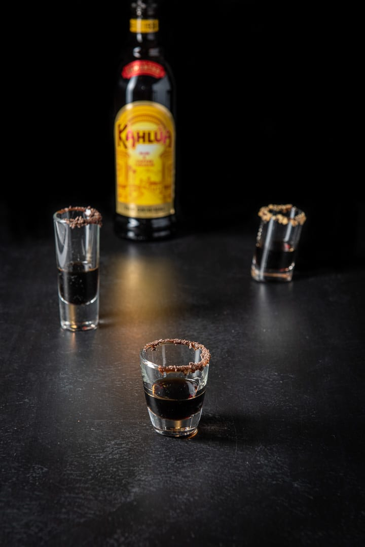 Kahlúa poured into the garnished glasses for the girl scout cookie shot