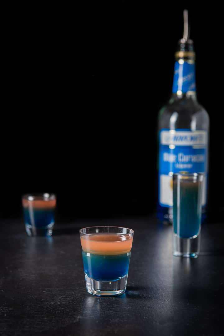 Blue curacao poured into the beveled glass for the jelly bean shot