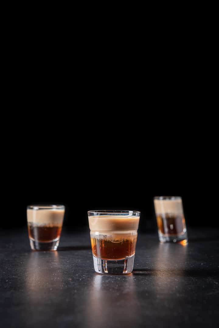 Vertical view of the beveled glass filled with the peanut butter and jelly shot