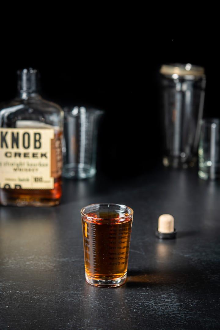 Bourbon poured out for the bourbon cranberry cocktail