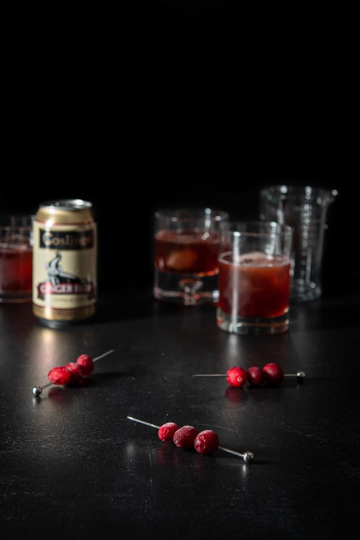 Frozen cranberries on skewers for the bourbon cranberry cocktail