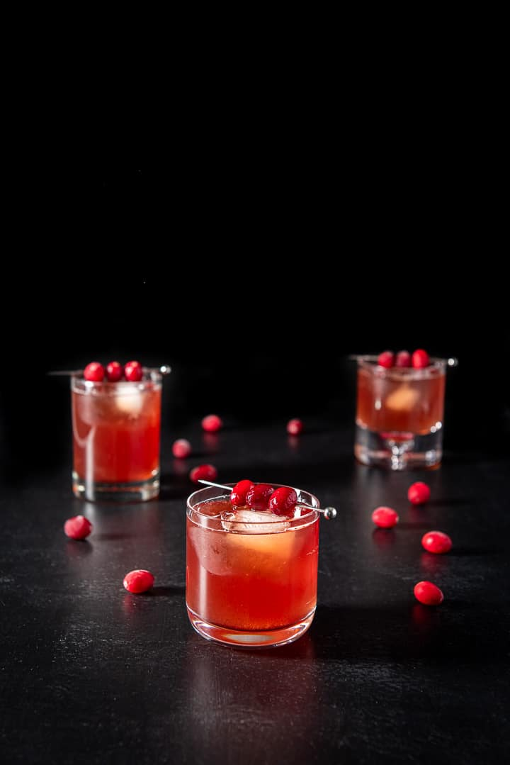 Short glass of the bourbon cranberry cocktail in front