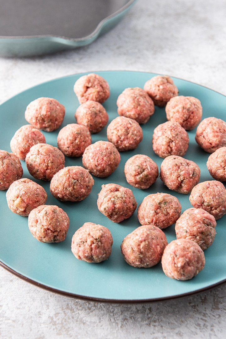 Rolled raw meatballs for the bourbon meatballs