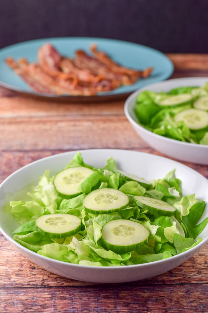 Cucumber slices on the pear and pomegranate salad