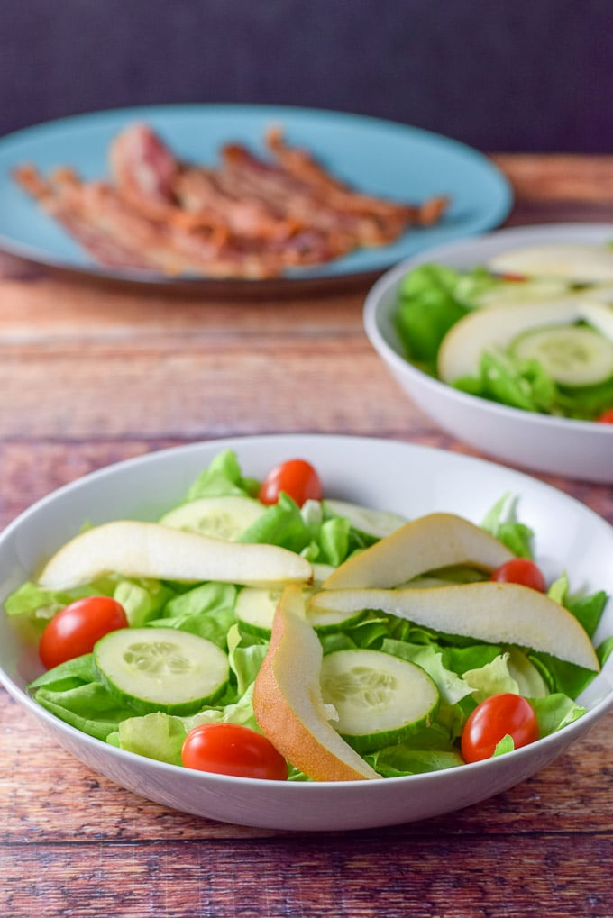 Pear slices added to the pear and pomegranate salad