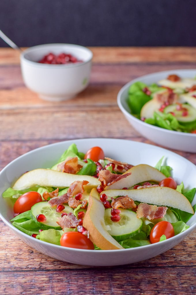Bacon crumbled on the pear and pomegranate salad
