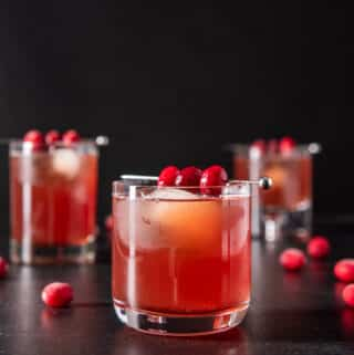 Square photo of the three glasses of bourbon cranberry cocktail
