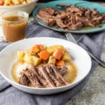 Square photo of the instant pot bottom round roast on a plate