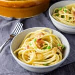 Bucatini Carbonara in a grey bowl - square