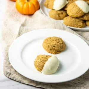 Pumpkin cream cheese cookies on a plate square
