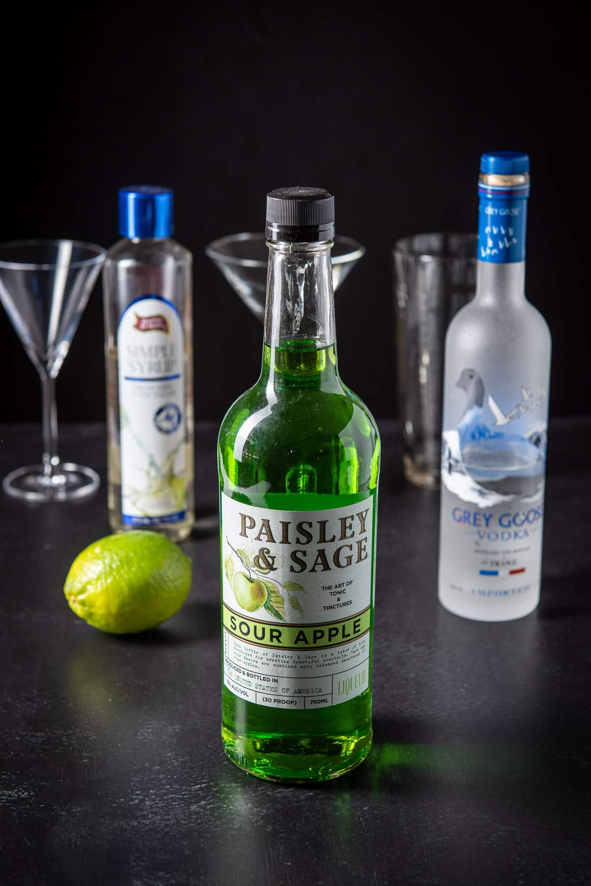 Sour apple liqueur, vodka, lime and simple syrup for the appletini cocktail