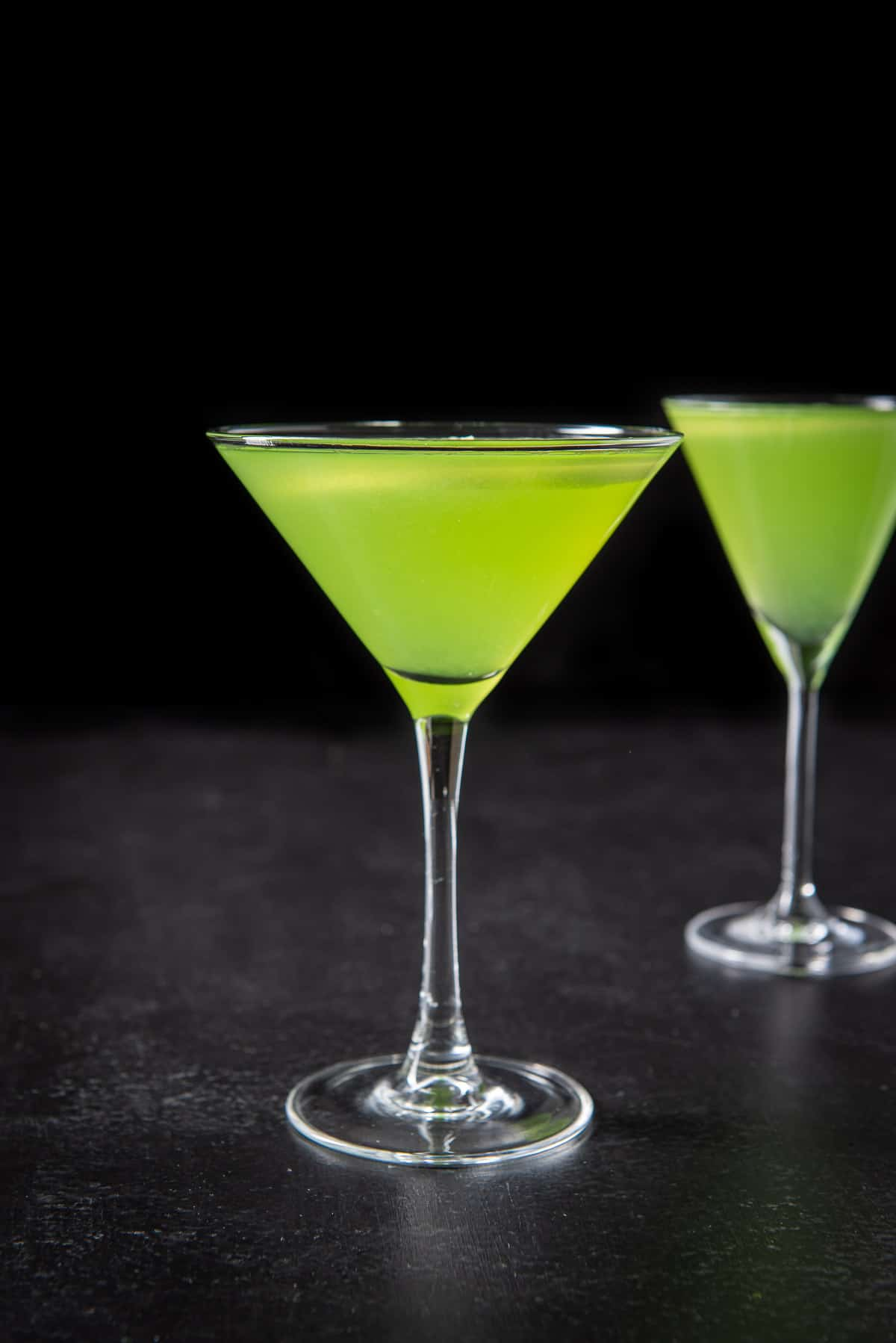 Vertical view of the sour appletini cocktail
