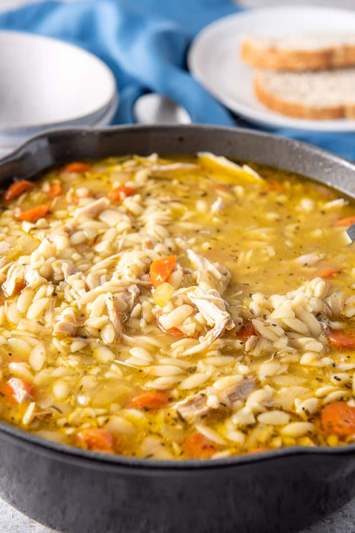 Cast iron pan filled with chicken soup